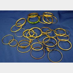 Seventeen Gold Bangle Bracelets