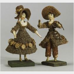 Pair of Small Early Grodnertal Shell Dolls