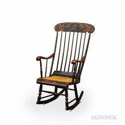 Black-painted and Stenciled Caned Rocking Armchair.