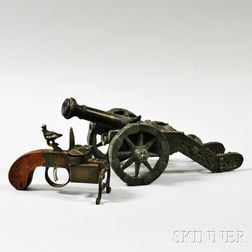 Miniature Patinated Bronze Cannon and a Dunhill Tinder Pistol.     Estimate $200-400