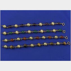 Four 18kt Gold and Stone Bead Bracelets