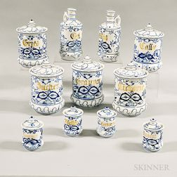 Set of Eleven Blue and White Ceramic Canisters and Cruets.     Estimate $200-300