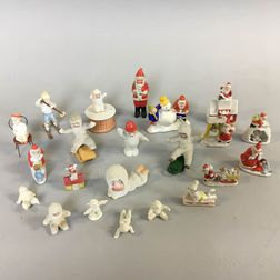 Nineteen Ceramic Santa Claus and Snow Baby Figures.     Estimate $250-350