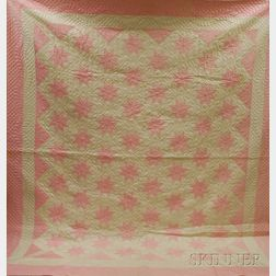 Hand-stitched Pink and White Sateen Pieced Star Pattern Quilt.     Estimate $250-350