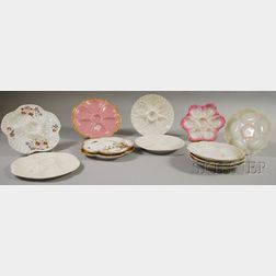 Twelve Assorted Gilt, Transfer, and Hand-painted Porcelain Oyster Plates
