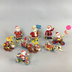 Eight Tin Santa Claus Wind-up Toys