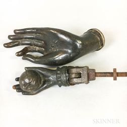 Cast Iron Door Knocker of a Hand and Apple and a Bronze Buddha Hand