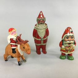 Three Tin Santa Claus Wind-up Toys