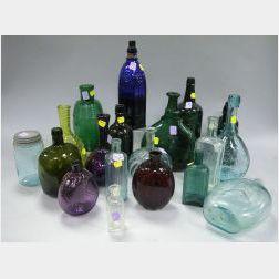 Twenty Colored Glass Bottles and Flasks.
