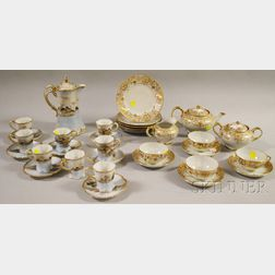 Seventeen-piece Nippon Gilt-decorated Porcelain Partial Tea Set and a Sixteen-piece Japanese Hand-painted Landscape-decorated Porcel...