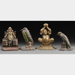 Four Polychrome Cast Iron Figural Doorstops