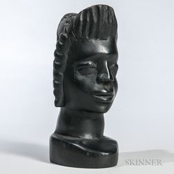 Carved Wooden Head of a Woman.     Estimate $150-250