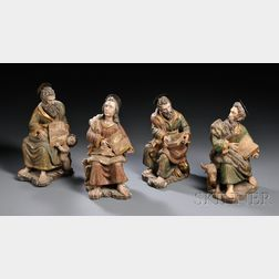 Set of Four Polychrome and Parcel-gilt Carved Figures of the Evangelists