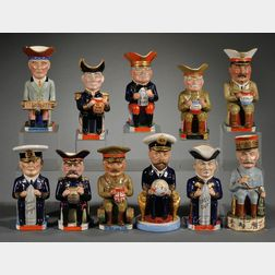 Set of Eleven Wilkinson Commemorative Toby Jugs