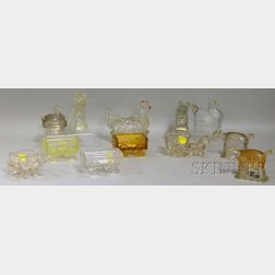 Twelve Mostly Colorless Pressed Glass Figural Candy Containers and Dishes