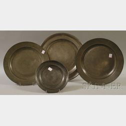 Three Pewter Chargers and a Plate