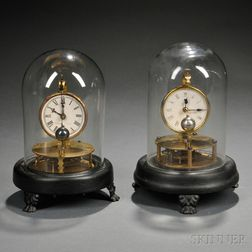 Two Brigg's Rotary Clocks
