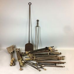 Approximately Thirty Brass and Iron Fireplace Shovels and Pairs of Tongs.     Estimate $200-300