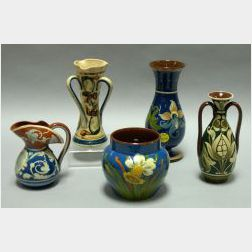 Aller Vale Scrolls Three-Handled Vase, a Watcombe Floral Two-Handled Vase, a Clifton Daffodil Pot, and a Torquay Floral Decorated Foote