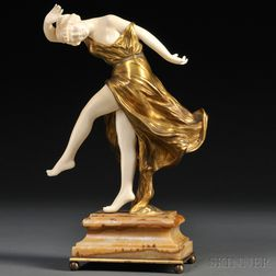 After Antoine Orlandini (French, 1886-1956)       Art Deco Bronze and Ivory Figure of a Dancing Maiden