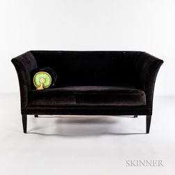 Black Velvet Loveseat and a Tasseled Pillow