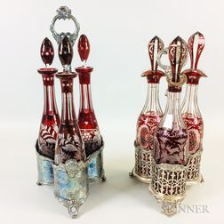 Two Ruby Cut-to-clear Decanter Sets in Silver-plated Stands