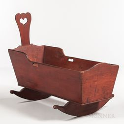 Red-painted Cradle with Heart Cutout