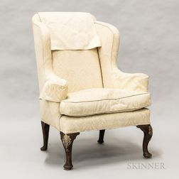 Georgian Upholstered and Carved Walnut Wing Chair