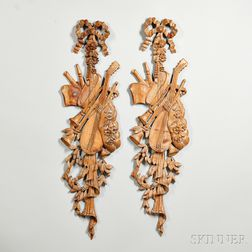 Pair of Carved Fruitwood Trophies