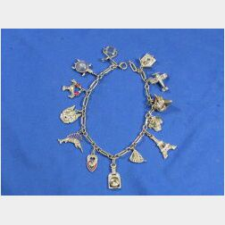 Platinum, Diamond and Gem-Set Charm Bracelet