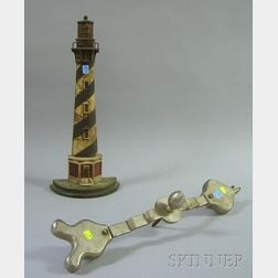 Painted Cast Iron Lighthouse Doorstop and a Gaming Wheel Metal Arrow