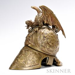 Bronze Helmet-form Inkwell, late 19th century, the helmet decorated with a figural mask centering embossed dragons and scrolled foliage
