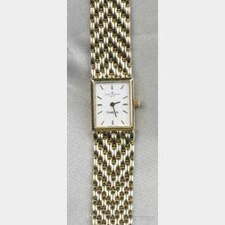 Lady's 14kt Gold Wristwatch, Baume & Mercier, retailed by Tiffany & Co.
