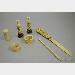 Asian Carved Ivory Paper Knife, Two Napkin Rings, a Pair of Miniature Vases, a Writing Implement, and a Needle ...