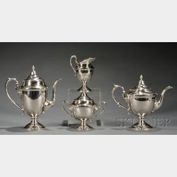 Four Piece American Sterling Classical Revival Tea and Coffee Service