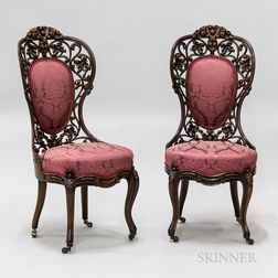 Pair of Rococo Revival Carved and Laminated Rosewood Side Chairs.     Estimate $250-350