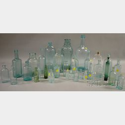 Thirty-five Mostly Aqua Blown and Molded Glass Bottles