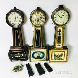 """Three Reverse-painted Mahogany """"Patent"""" Timepieces"""