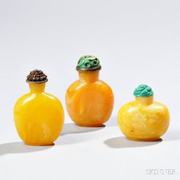 Three Reconstituted Amber Snuff Bottles