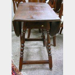 William & Mary Style Walnut Drop-leaf One-Drawer Splay-leg Butterfly Table.