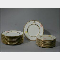 Twenty-four Lenox and Cauldon Gilt Decorated Porcelain Plates