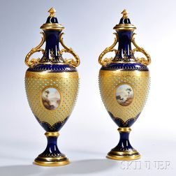 Two Similar Jeweled Coalport Porcelain Vases and Covers