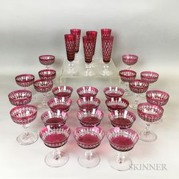 Thirty Pieces of Cranberry Cut-to-clear Glass Stemware