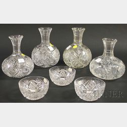 Four Colorless Cut Glass Carafes and a Set of Three Colorless Cut Glass Fingerbowls.