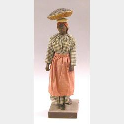 Plaster Model of Black Woman in Traditional Cotton Clothing Carrying Basket of   Produce.