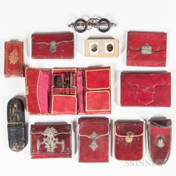 Group of Red Leather Cases, Wallets, and Necessary Kits