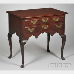 Queen Anne Carved Walnut Dressing Table with Paw Feet