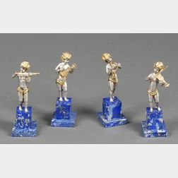 Set of Four Small Italian Silver and Silver Gilt Figures of Cherub Musicians
