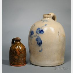 """Norton & Fenton, East Bennington, Vt."" Cobalt Floral Decorated Three-Gallon   Stoneware Jug and a Mottled Glazed Redware Jug"