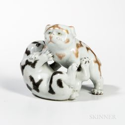 White-glazed Porcelain Figurine of Two Puppies Wrestling